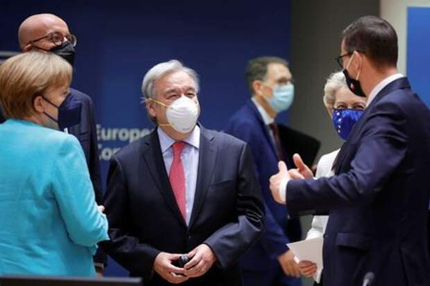 United Nations Secretary General Antonio Guterres, center, talks to European Council President Charles Michel, second left, Germany's Chancellor Angela Merkel, left, European Commission President Ursula von der Leyen, second right, and Polish Prime Minister Mateusz Morawiecki during an EU summit at the European Council building in Brussels, Belgium, June 24, 2021. Olivier Matthys/Pool via REUTERS