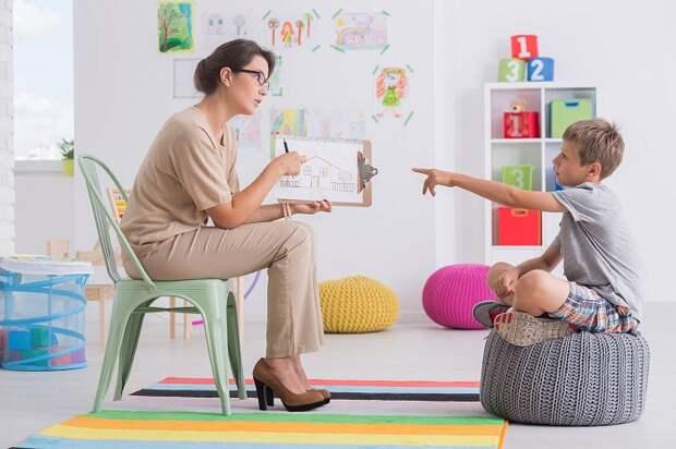 woman-conducting-childs-psychological-test-PSRNUKL-1 (1).jpg