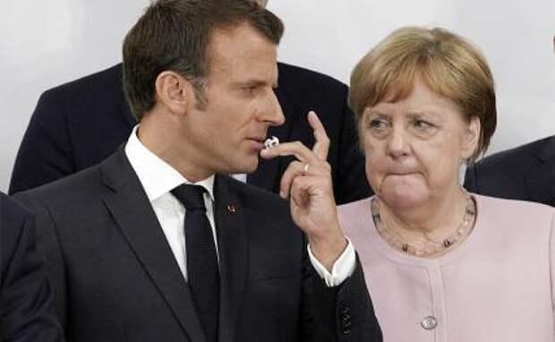 На фото: президент Франции Эммануэль Макрон и канцлер Германии Ангела Меркель