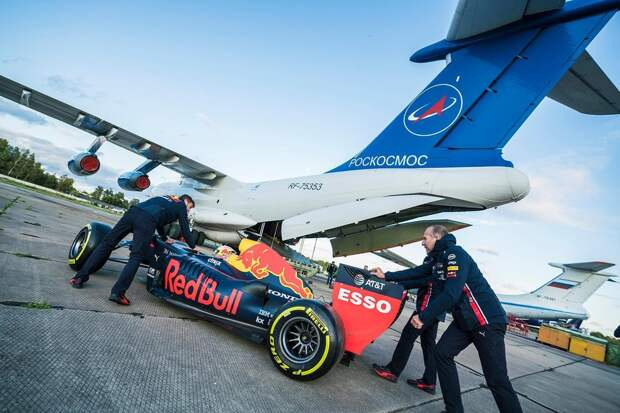 Packing Aston Martin Red Bull Racing's F1 car onto a plane ahead of the Zero-G pitstop aboard an aircraft in Russia.