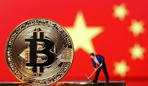 FILE PHOTO: A small toy figurine is seen on representations of the Bitcoin virtual currency displayed in front of an image of China's flag in this illustration picture, April 9, 2019. REUTERS/Dado Ruvic/Illustration