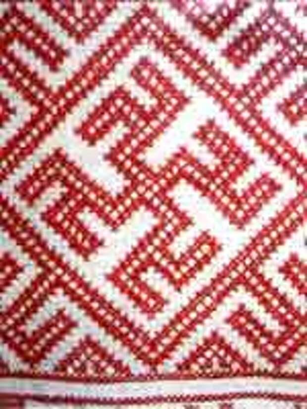 Свастика на фрагменте подола женской рубахи. Конец 20 в. Грязовецкий район
