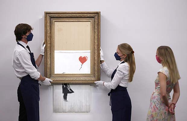 На Sotheby's самоуничтожившуюся картину Бэнкси «Любовь в мусорном баке» продали за $25,5 млн