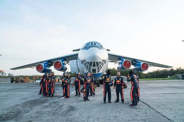Aston Martin Red Bull Racing's mechanics pictured in front of the 'vomit comet' aircraft ahead of the Zero-G pitstop aboard an aircraft in Russia.