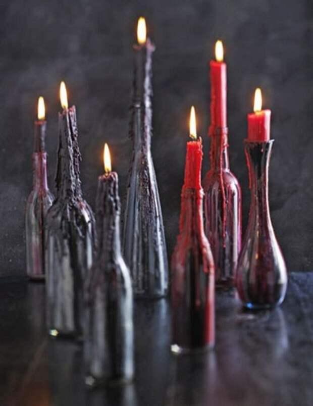 Красные свечи в бутылках