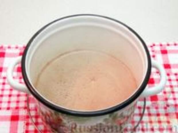 Фото приготовления рецепта: Шоколадная рисовая каша на молоке - шаг №6