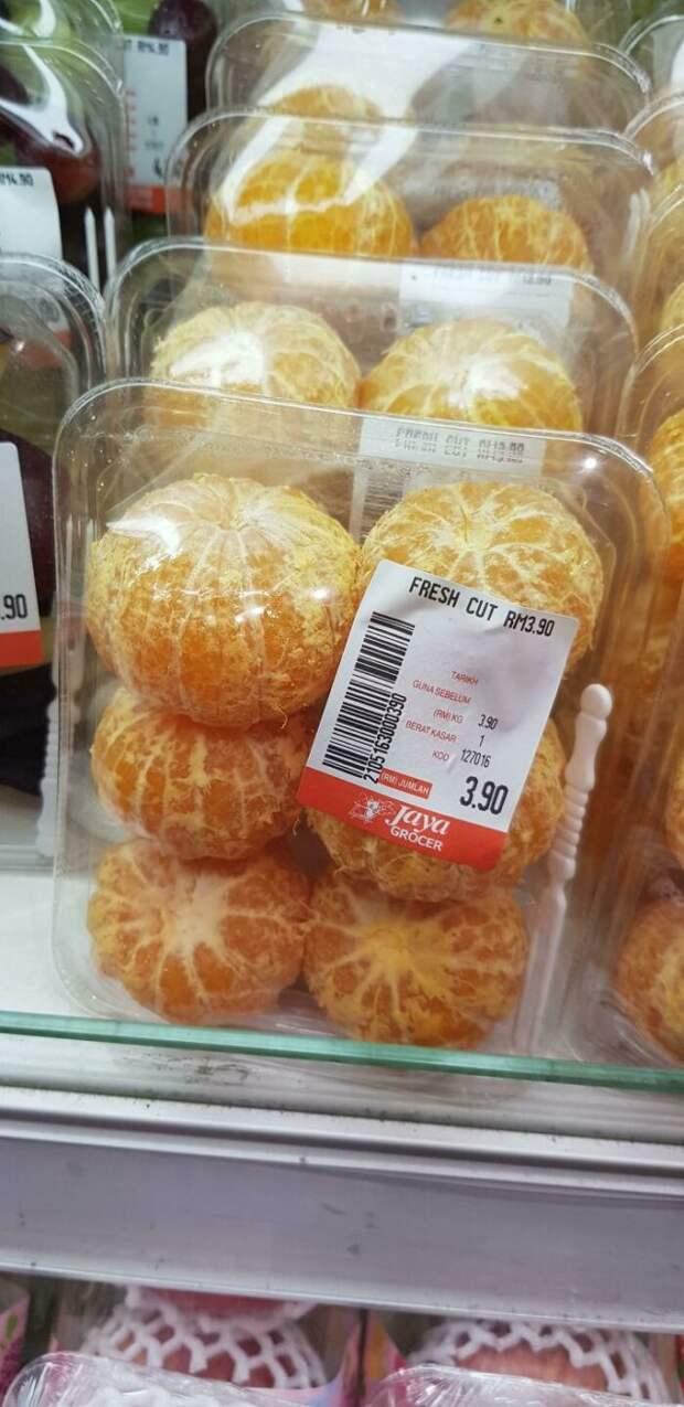 очищенные апельсины в упаковке