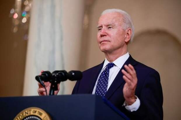 FILE PHOTO: U.S. President Joe Biden speaks in the Cross Hall at the White House in Washington, U.S., April 20, 2021. REUTERS/Tom Brenner/File Photo