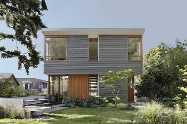 Отделка фасада дома - фото металлических панелей на фасаде