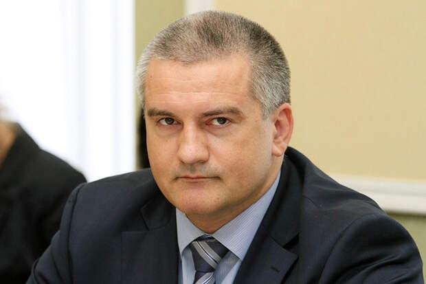Премьер-министр Крыма Сергей Аксенов возглавляет ту же самую Федерацию вольной борьбы, где руководит Кожухарь