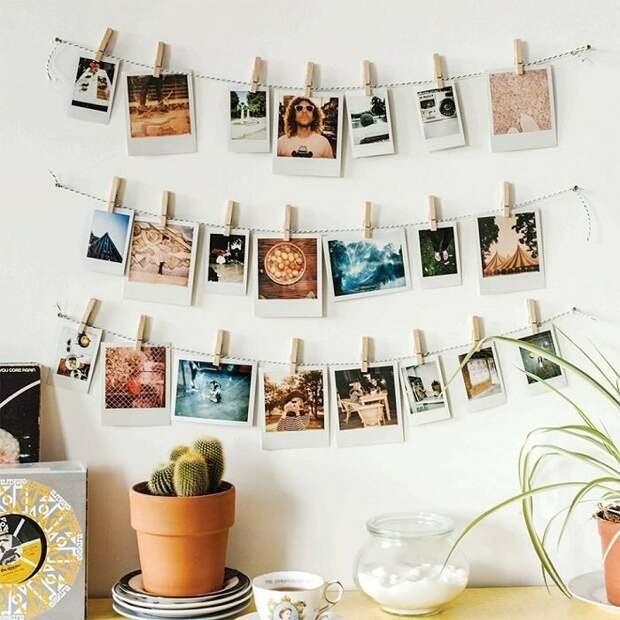 Фотографии на прищепках - отличное украшение для стен. / Фото: Roomble.com