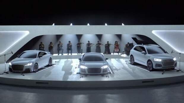 Первые скрипки - автомобили Audi играют в симфоническом оркестре