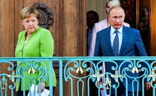 На фото: канцлер Германии Ангела Меркель и президент РФ Владимир Путин во время встречи