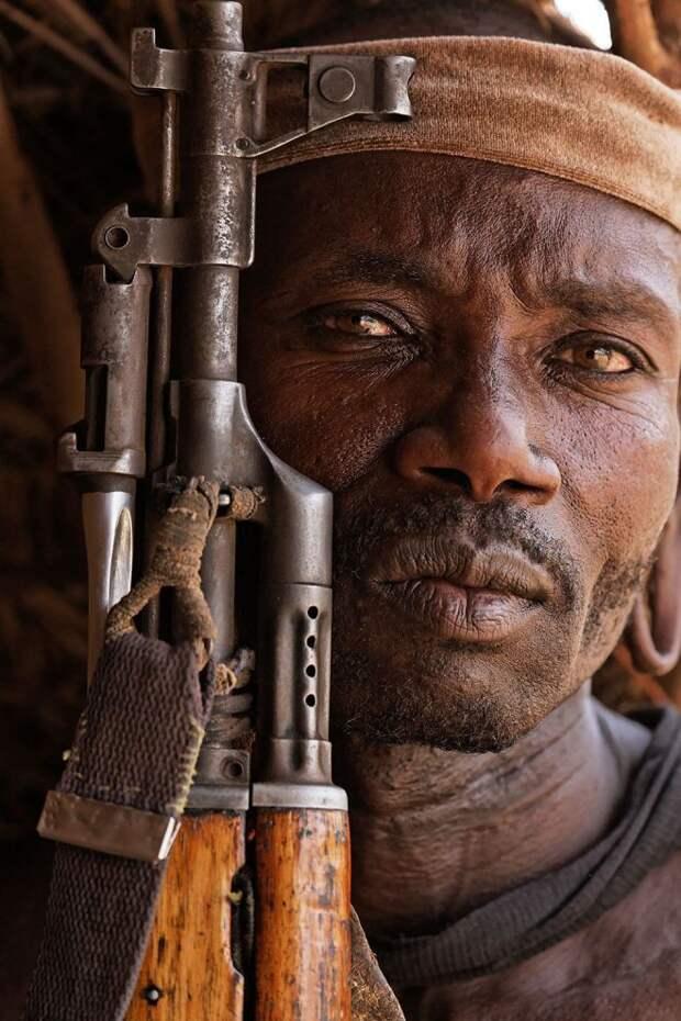 Мужчина с оружием