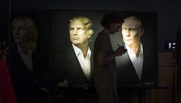 Портреты президента США Дональда Трампа и президента России Владимира Путина в пабе Юнион Джек в Москве