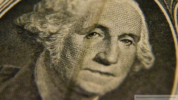 Переоцененный доллар может подешеветь вдвое