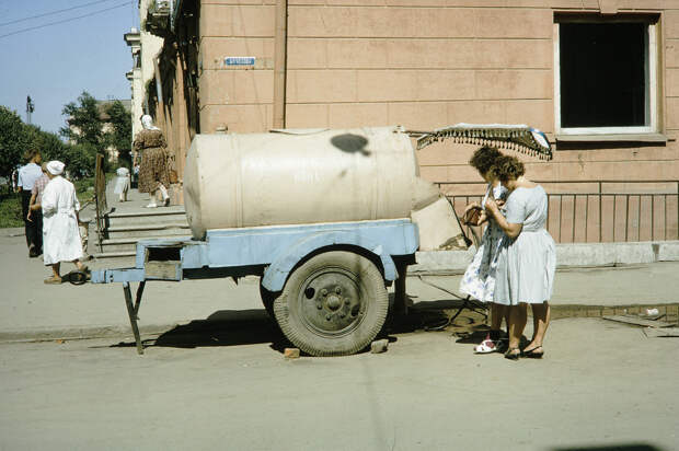Russia, women making purchase from milk truck. Siberia