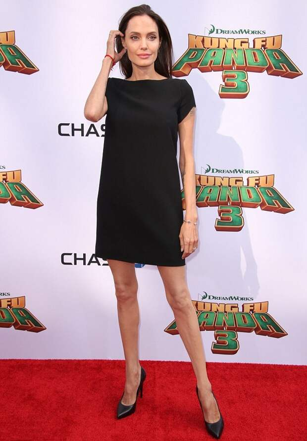 303BE51D00000578-3403084-Angelina_donned_a_black_Saint_Laurent_shift_dress_pairing_the_si-m-46_1452994393782.jpg