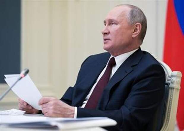 Russian President Vladimir Putin delivers a speech during a virtual global climate summit via a video link in Moscow, Russia April 22, 2021. Sputnik/Alexei Druzhinin/Kremlin via REUTERS ATTENTION EDITORS - THIS IMAGE WAS PROVIDED BY A THIRD PARTY.