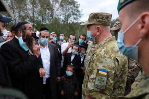 Сотни хасидов пытаются попасть на Украину, штурмуя границу