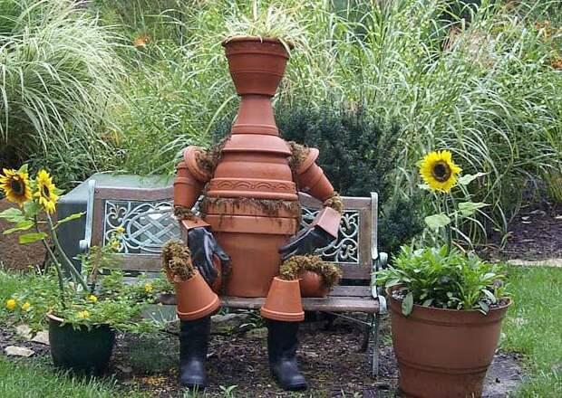 фигурка для сада из керамических горшков