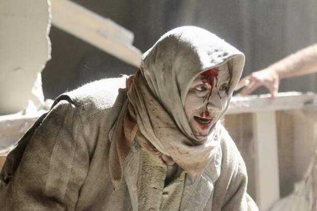 Раненная женщина