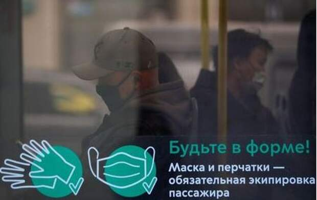 Passengers wear protective face masks in a bus amid the outbreak of the coronavirus disease (COVID-19) in Moscow, Russia October 29, 2020. A sign on a window reads: