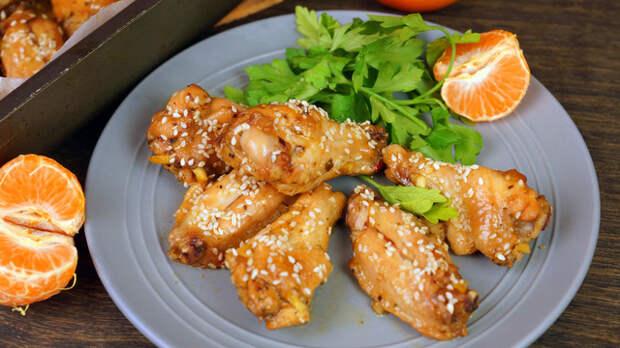 Фото к рецепту: Куриные крылышки по китайскому рецепту в апельсиновой глазури с кунжутом
