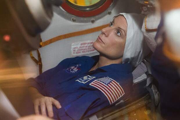 """In the Integration Facility at the Baikonur Cosmodrome in Kazakhstan, Expedition 48-49 crew member Kate Rubins of NASA conducts a """"fit check"""" familiarization aboard the Soyuz MS-01 spacecraft June 25 as part of the preparations for launch with Anatoly Ivanishin of Roscosmos and Takuya Onishi of the Japan Aerospace Exploration Agency on July 7, Baikonur time for a planned four-month mission on the International Space Station."""
