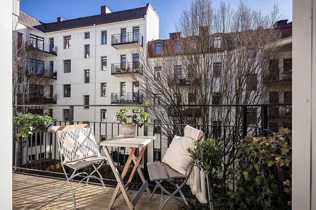 Белоснежный интерьер с тёплыми акцентами в квартире в Гётеборге (133 кв.м)