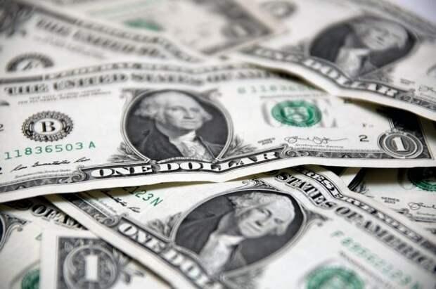 Курс доллара на четверг снизился на 74 копейки