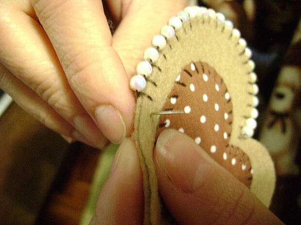 Smart: add a bead to blanket stitches for a pretty beaded boarder.