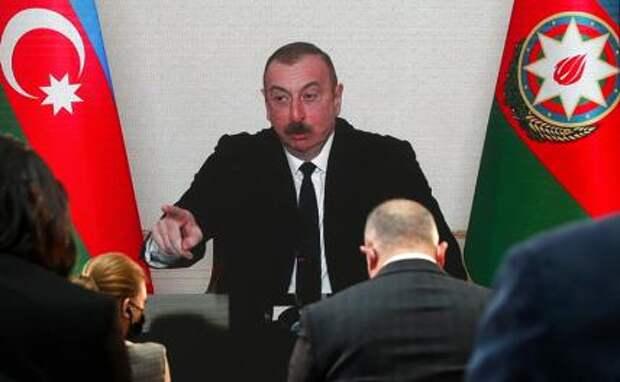 На фото: президент Азербайджана Ильхам Алиев во время пресс-конференции в режиме видеоконференции.