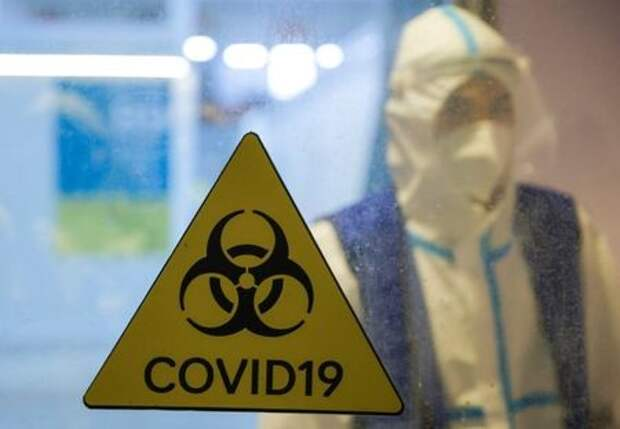 A medical specialist is seen at the Krylatskoye Ice Palace, which was converted into a temporary hospital for people suffering from the coronavirus disease (COVID-19), in Moscow, Russia, January 20, 2021. Picture taken January 20, 2021. REUTERS/Maxim Shemetov