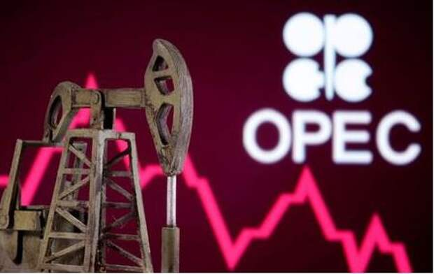 A 3D printed oil pump jack is seen in front of displayed stock graph and Opec logo in this illustration picture, April 14, 2020. REUTERS/Dado Ruvic/Illustration