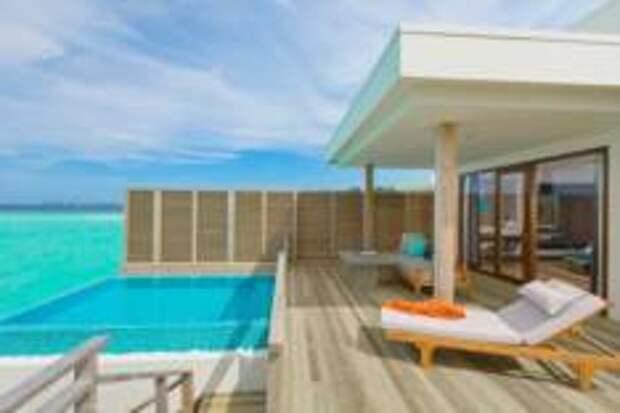 В номере отеля Dhigali Maldives