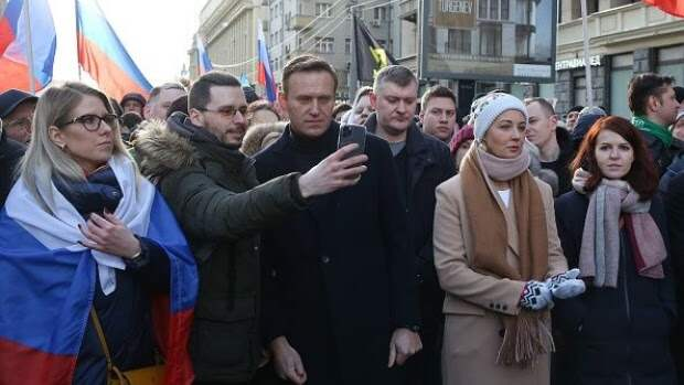 Alexey Navalny, Russian opposition leader, center, takes a selfie photograph with an attendee, as his wife Yulia, center right, stands by during a rally in Moscow, Russia, on Saturday, Feb. 29, 2019. The rally marked five years since the assassination of politician Boris Nemtsov.