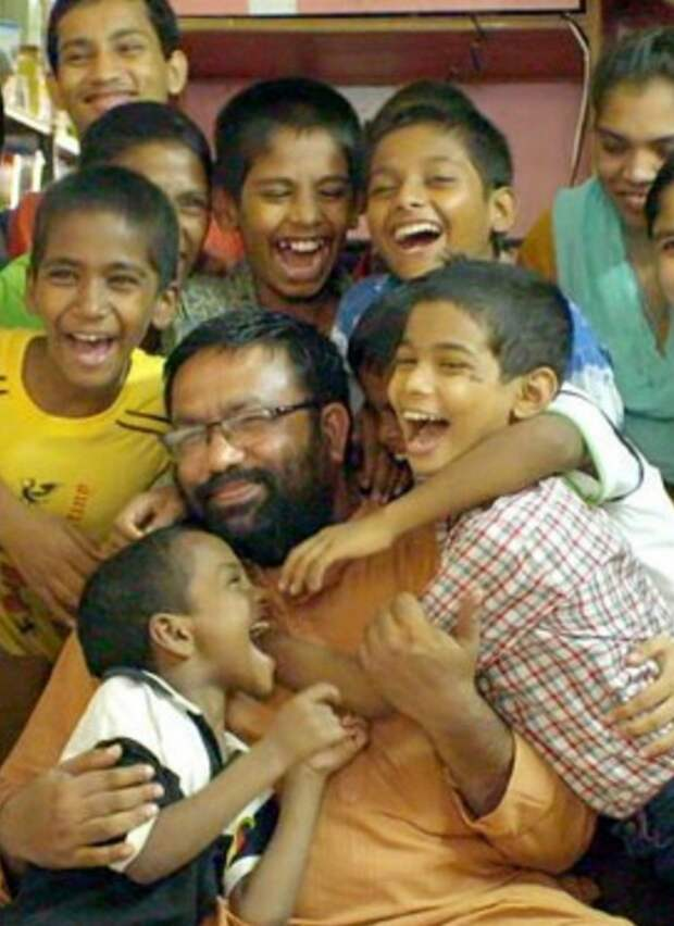 Pic from Caters News - (Pictured: Papa Reji, Rajib Thomas and the kids he adopted.) - An Indian man has become a father to two dozen children after adopting 22 HIV positive boys, who were abandoned by their parents after being struck by the diseased. Called lovingly as Papa Reji, Rajib Thomas, 44, from Mumbai, India has been taking care of the once homeless HIV positve children for almost a decade now. He accommodates all his children in his home where he lives with his wife and two kids- Justin 18 and Jenny, 16. While his wife Mini Reji cooks all the three meals for their kids, Papa Reji takes care of their education and heath. Papa Reji was working in the social sector when an incident changed his life forever and made him a father of these special children. SEE CATERS COPY