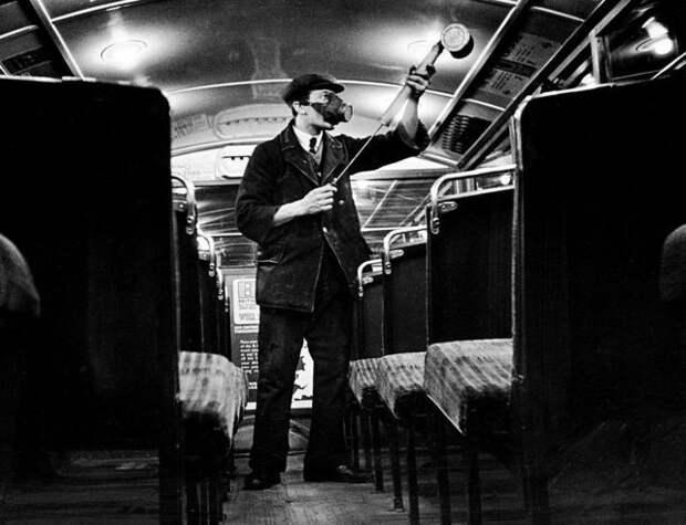 Man spraying bus with anti-flu