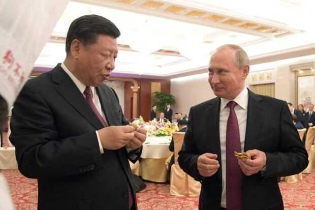 Jiji: растущее противостояние междуКНР и США наруку России